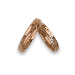 Diamonds rose gold wedding bands with central binary shape whale tail. Nine white diamonds. Model vq534544